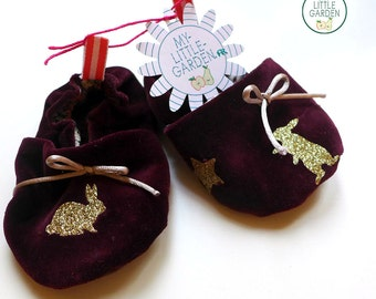 In purple velvet rabbits or birds baby shoes