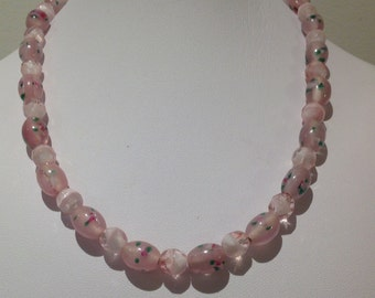 Necklace. 43 cm.  Lampwork glass oval features. Followed by Czech fire polished spacers. Pink