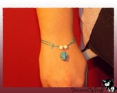 Light blue bracelet with light blue sugar skull charm & white beads