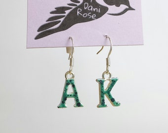 Green speckled Ak dangle earrings
