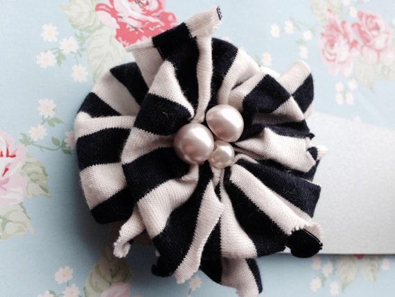 Navy and cream fabric flower brooch, with pearl effect buttons