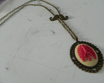 Long rib cage cameo necklace with mustache