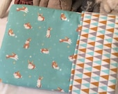 Organic baby quilt. Rabbits on lush green. Gender neutral. Modern organic baby quilt by Avie and Mabel.
