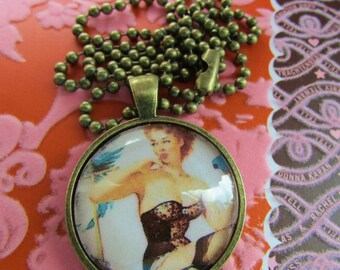 Gil Elvgren Pinup Pendant in Brass Setting Under Polished Glass