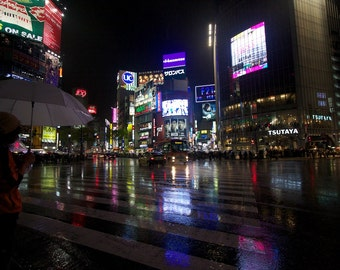 Shibuya crossing at night in the rain.  Tokyo, Japan