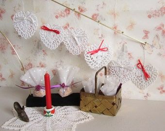 Hearts- Lacy decorative and handcrafted  using  a crochet stitch.  Each heart is embellished with a red or white ribbon.