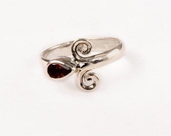 Vintage Silver Ring with fine Garnet Gem .    Unique design.