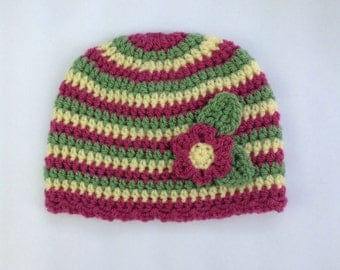 Bright striped hat with flower detail