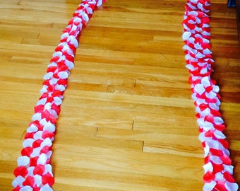 Two 50 ft red and white rose petal aisle runner