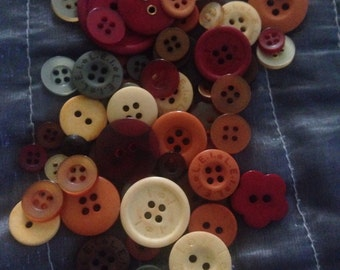 Giant bag of Fall-colored buttons