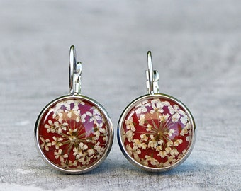 Earrings with real blooms on burgundy