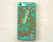iPhone 5, 5s smartphone case. Unique. Handmade. Rhinestones: orange spirals, flower. Key charm. Transparent durable turquoise soft case.