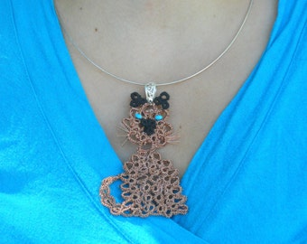 Tatted Siamese cat pendant.