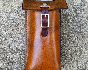 Leather water bottle holder.