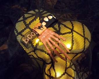 Trick or Treat? Skeleton Hand Clip