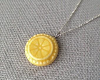 slice necklace, yellow ... handmade porcelain jewelry by Sofia Masri
