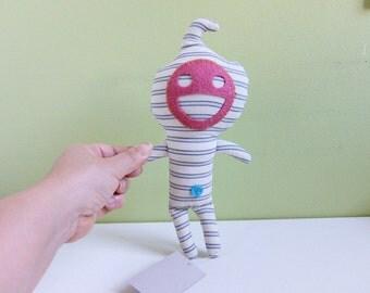 Feel Good Doll, stripe