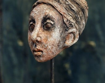 Woman head sculpture