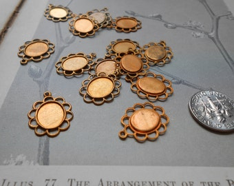 12 antique brass lacey filigree setting charms fits 8 x 10 cab - vintage old new stock jewelry supplies