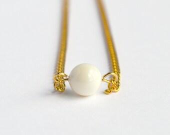 Ivory cream delicate minimal Swarovski pearl necklace on gold chain