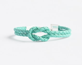 Turquoise vinyl bolo cord forever knot nautical rope bracelet with your choice of silver anchor, heart or ship wheel charm