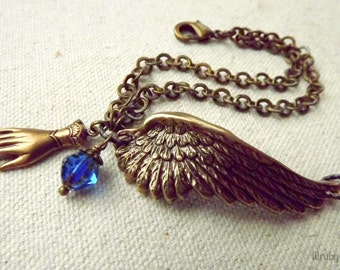 Angel wing bracelet , vintage inspired, hand charm and blue Czech glass bead