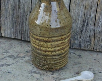 a stoneware bottle for syrup, olive oil, or soy sauce