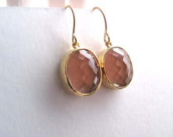 Pink oval earrings, faceted glass in 16k gold plated frames on 14k gold fixtures