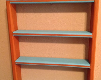 Southwest shelf hand painted blue sky red earth with concho decoration