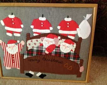 Quilted Appliqued 3D Santas in Bed wall art Beautiful Red and black design soft beautiful art