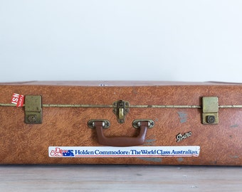 large tan vintage suitcase