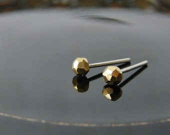 Tiny golden studs. Minimalist faceted stud earrings in brass and silver. Small geo earrings.