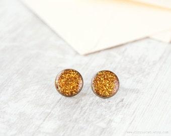 Gold glitter stud earrings 16 mm