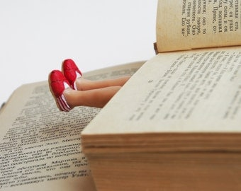 TOMs shoes bookmark. Legs in the book. Red.