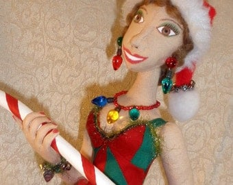 17 inch Christmas pin up style cloth doll in red and green with candy cane