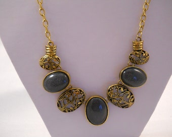 Bib Necklace with Deep Gold Tone and Grey/Green  Pendants on a Gold Tone Chain