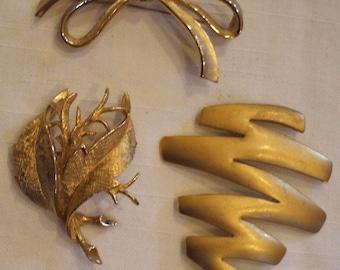 Three gold toned pin lot