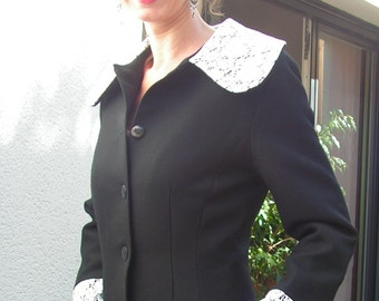 "Black wool coat, half seasons,  waisted, ""Claudine"" collar in white cotton lace. 8414"