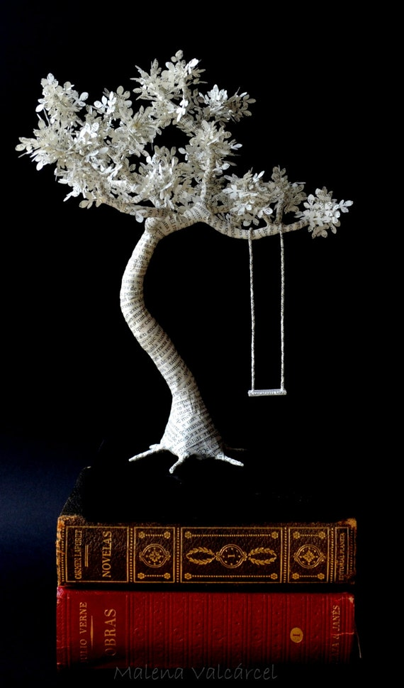Book paper sculpture tree with swing on wood