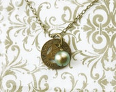 Transit Token Necklace Buffalo, NY with vintage brass token and olive green pearl, Buffalove jewelry