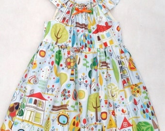 A summer dress in a light blue print with trees, houses and birds to fit age 3 years