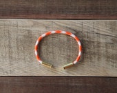 Dreamsicle Camo Bullet Casing Bracelet recycled .22lr casings orange white paracord wire BRZN