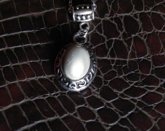 Silver and white pendant necklace