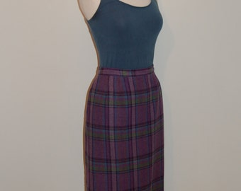 A classic 1950s tartan vintage pencil skirt in purple, lilac, green and blue