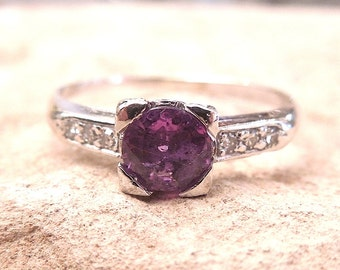 Pink Sapphire in Platinum Mounting with Diamonds