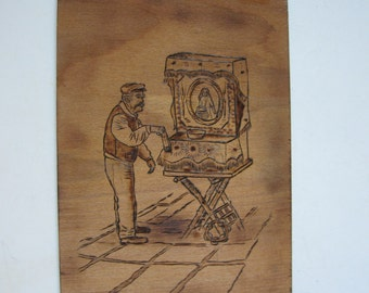 vintage pyrography on wood, peripatetic barrel organ player