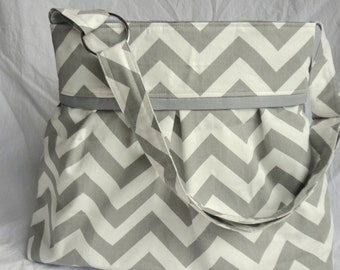 Pleated Diaper Bag large in gray chevron and gray lining.  Adjustabe strap with elastic bottle pockets