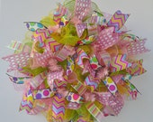 Whimsical Ruffle Summer Deco Mesh Wreath with pastel pink, lime green and daffodil yellow metallic deco mesh and four fun and funky ribbons.