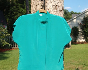 Haberdas-Her Classic Tailoring Teal Cap Sleeve Blouse!
