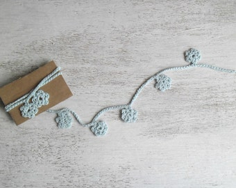 Decorative flowers garland spring light blue home decor